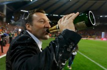 Belgium's soccer team coach Wilmots celebrates with champagne after a 2014 World Cup qualifying soccer match against Wales in Brussels