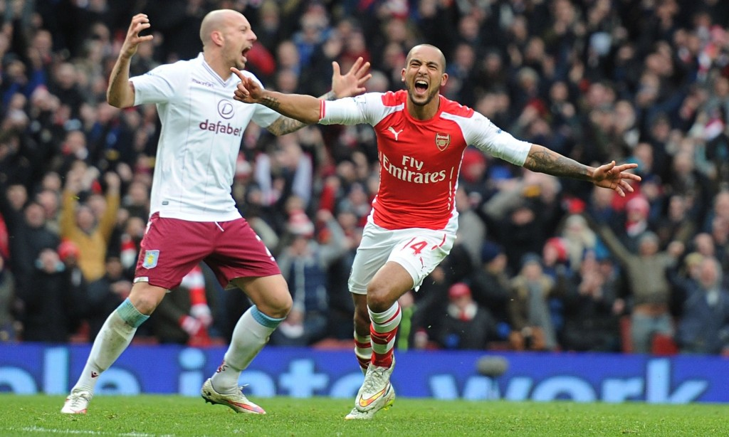Theo Walcott celebrates his goal against Aston Villa on the occasion of his first Premier League sta